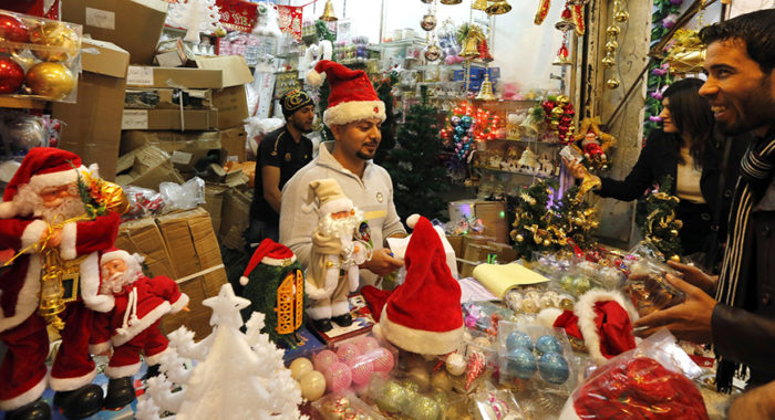 Iraqis shop for Christmas and New Year decorations and gifts at central Baghdad's Shorja market on December 20, 2014 in the lead up to the Christian religious festival celebrating the birth of Jesus Christ. AFP PHOTO / SABAH ARAR (Photo credit should read SABAH ARAR/AFP/Getty Images)